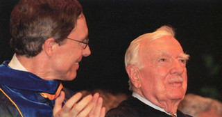 President David Oxtoby with Walter Cronkite during the 2004 Commencement ceremony.