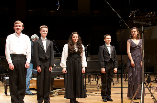 Bryan Dunnewald, Emily Switzer, and members of the Colorado Children's Chorale rehearsing the final bow | by From the Top, Inc.