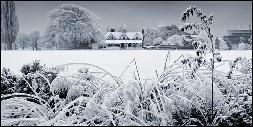 UK - Oxford - University Park - Cricket Pavilion in snow_panorama mono