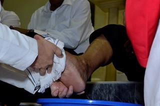5.Act of Feet washing closeup | by Johnragai-Moment Catcher