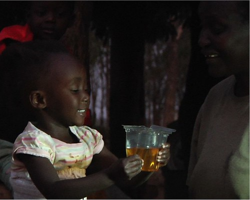 Girl drinking from Kit Yamoyo - this is what success looks like for ColaLife. | by ColaLife