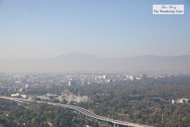 View of west Mexico City from the rooftop of Hyatt Regency (at the helipad) with a hazy view of the Sierra Madre mountains