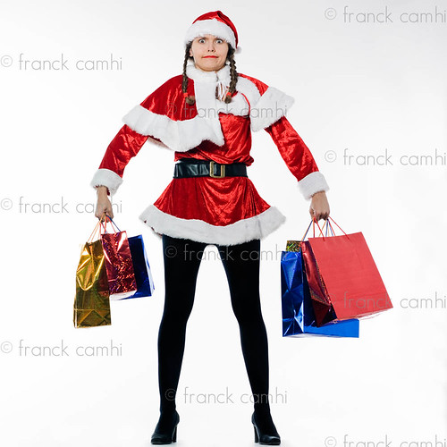 santa claus woman holding christmas bags | by Franck Camhi