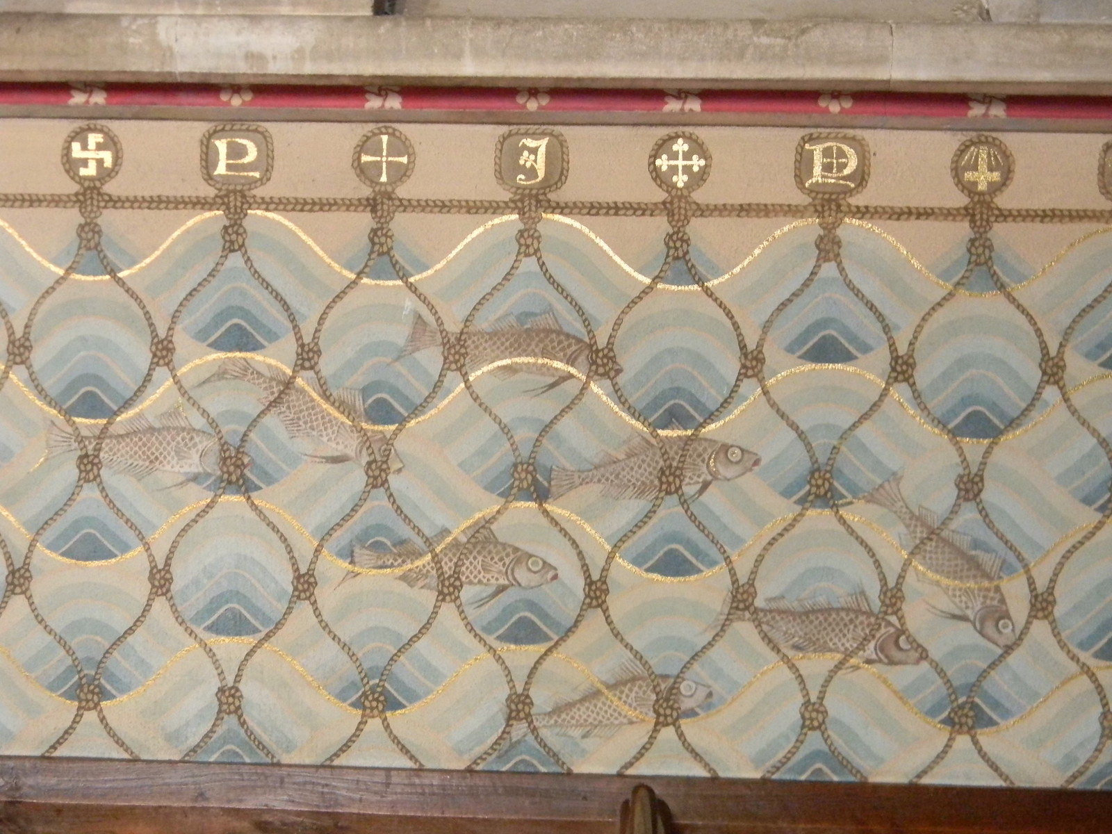Interior, Hascombe Church Milford to Godalming This fishy frieze stretches round three sides.