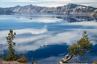 Clouds, reflected in Crater Lake | by Edward Mitchell