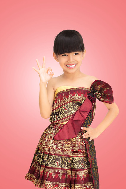 Thai little girl with thai traditional clothes style