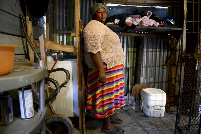 """Nombini has two Porta Potties, which are used by the 12 people who live in her home. When she first moved to Khayelitsha in 2005, she did not have a toilet so she had to go in the bush, across a main road.<br /> <br /> """"It was terrible in the bush, the cars hit you. When we were given a Porta Potty in 2009, it was much better than going in the bush. Flush toilets are first class compared to the Porta Potty though. My dream is to have a flush toilet."""" Eric Miller, assisted by Social Justice Coalition."""