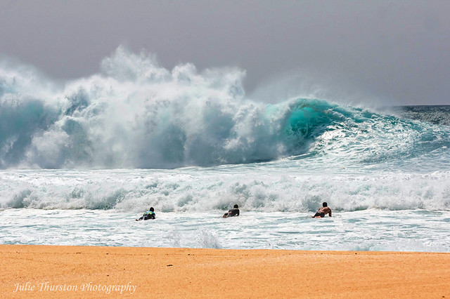 The Surfers Heading Out to the Monster Waves