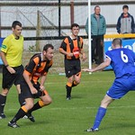 Sean Croll keeps a close eye on opposite number Martin McMullan