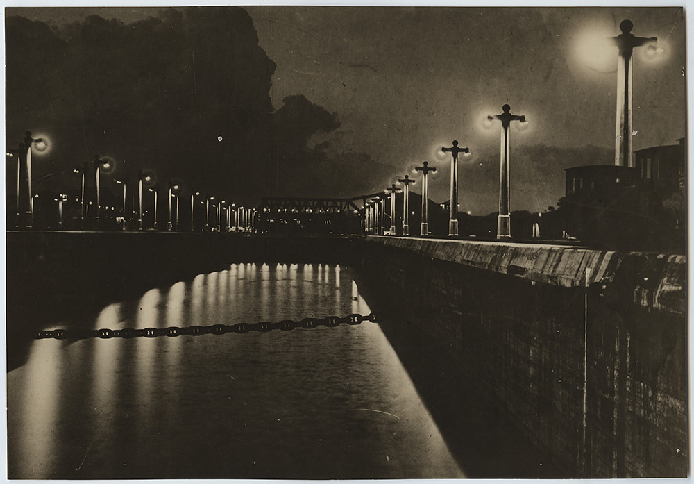 Gatun Locks, Panama Canal at night showing Donkey Locos