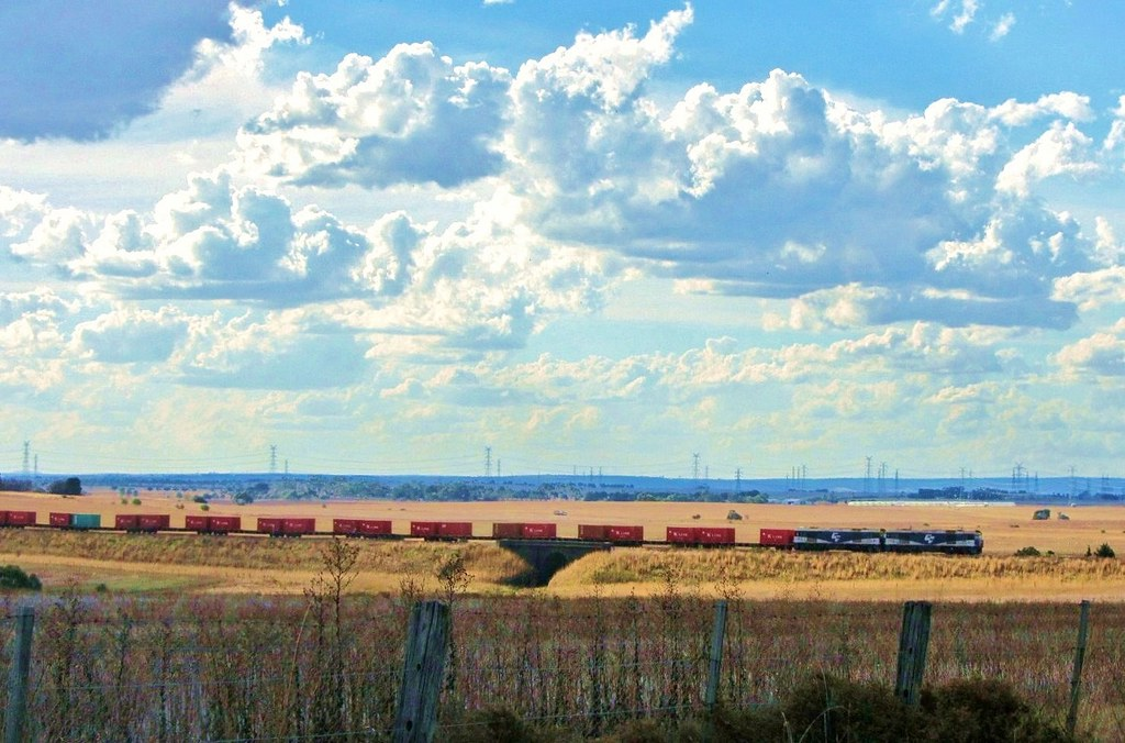 Locomotive GL105 hauls a failed GL104 with the Melbourne bound goods ex Horsham near Moorabool, Vic by Adam Serena