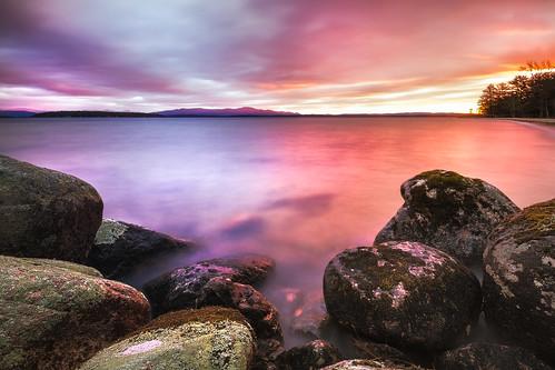 lake water sunrise rocks day cloudy shoreline newhampshire shore gilford lakewinnipesaukee ellacoyastatebeach robertallanclifford cliffordphotographynhcom