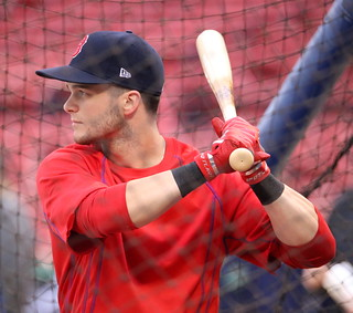 Red Sox outfielder Andrew Benintendi takes batting practice during Saturday's workout at Fenway Park.