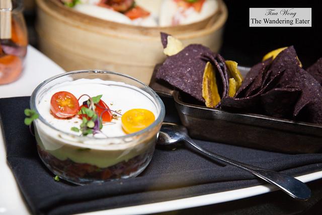 Three layer avocado dip, blue corn tortilla, plantain chips, roasted tomato pico de gallo