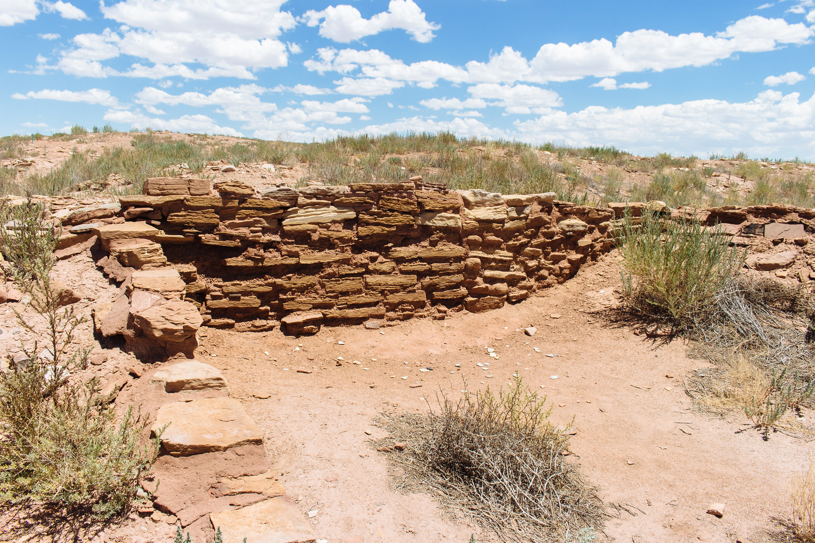 Crumbling stone walls on the high desert in Homolovi State Park in Arizona