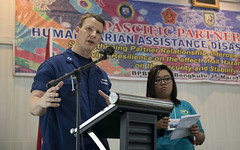 Lt. Christopher Kimrey delivers a presentation during a humanitarian assistance and disaster relief (HADR) seminar in Bengkulu, Indonesia as a part of Pacific Partnership, April 3. (MC2 Joshua Fulton)