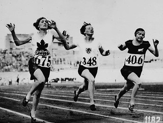 Myrtle Cook of Canada (left) winning a preliminary heat in the women's 100 metres race at the VIIIth Summer Olympic Games / Myrtle Cook (à gauche), du Canada, remportant une éliminatoire pour l'épreuve du 100 mètres femmes, aux VIIIe Jeux Olympiques