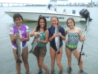 The girls catch barracuda. | by AdventureMIke.com