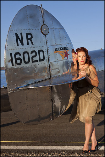 california sunset portrait woman reflection sexy classic plane canon silver airplane mirror flying shiny colorful bright aircraft aviation transport cheesecake retro redhead airshow lockheed pinup electra