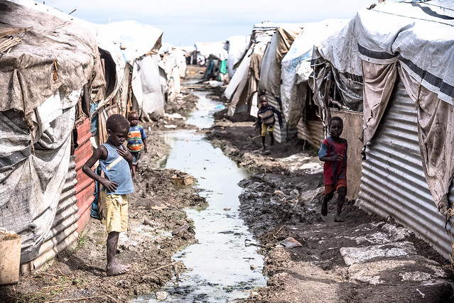 The camp is a vast agglomeration of flimsy tents, with open sewers like these punctuating the area. In the rainy season, or almost half the year, the area turns into a muddy, squelchy mess, making small chores like going out to collect water an ordeal.
