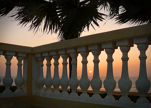 gambia2 gambia thegambia africa pillars columns sunset yellow oranges sea palmtrees palmtreeleaves evening dusk horizon lintels