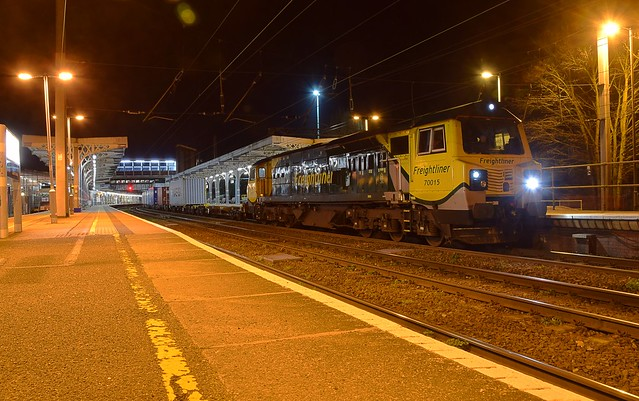 70015 waits the road for Ipswich Yard at the Station, with the 14.03 Intermodal from Ditton. 05 04 2018