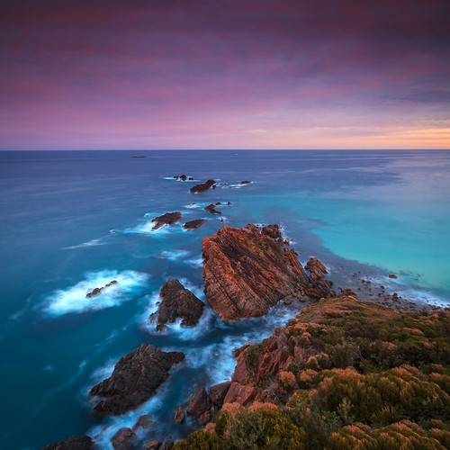 blue sunset beach rocks waves horizon australia sugarloaflighthouse