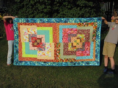 Zoë's quilt, bound and ready for washing. She picked all the fabrics from her stash. I cut and pieced the top, and did the hand-binding. Amy Qualls-McClure did the quilting.