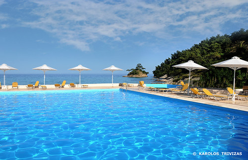 blue sea summer beach water pool clouds relax island hotel holidays rocks view turquoise hill aegean swimmingpool greece macedonia shore umbrellas idyllic slope piscine chaiselongue thasos armchairs aegeansea makedonia digitalcameraclub limenas thasosisland blinkagain