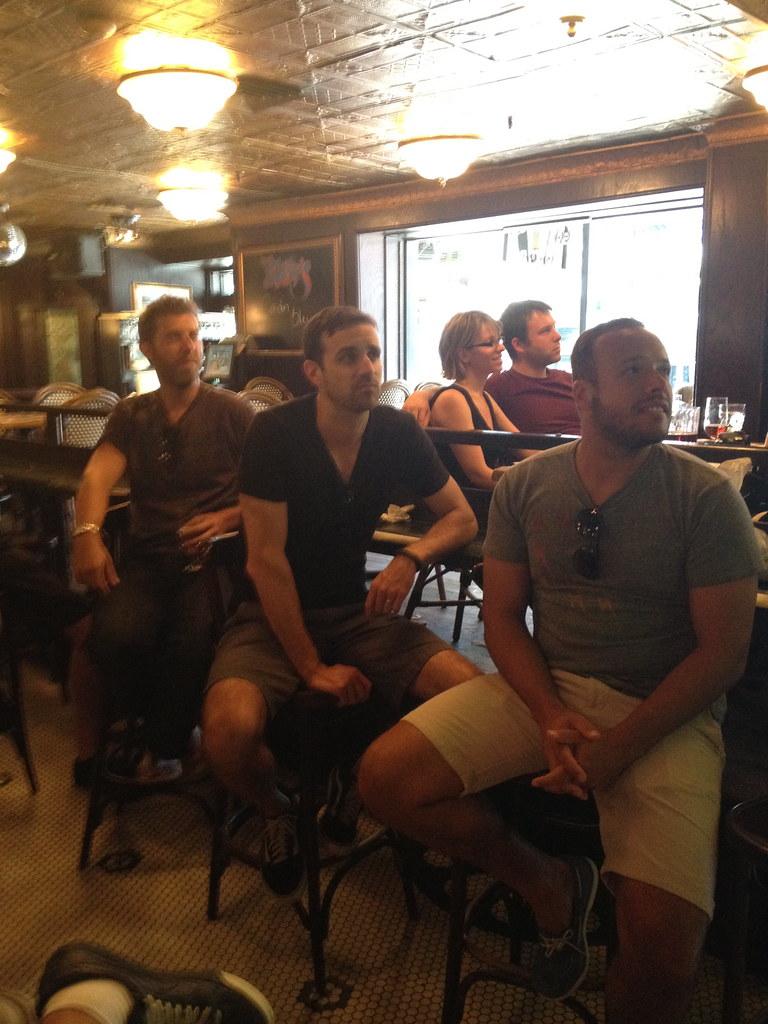 Adam, Mark, Gui watching men kick a ball | Matt Helland | Flickr