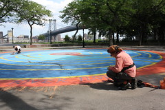 Paul Yanchyshyn and Diana Carulli give new color to a painted labyrinth in East River Park.