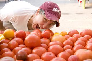 Shonda eating Gibbs Road Farm tomatoes (June 2012)   by Brookside Farmers' Market