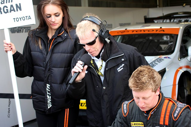 Adam Morgan and Zoe James in the pit lane ahead of the BTCC race at Donington Park in April 2012