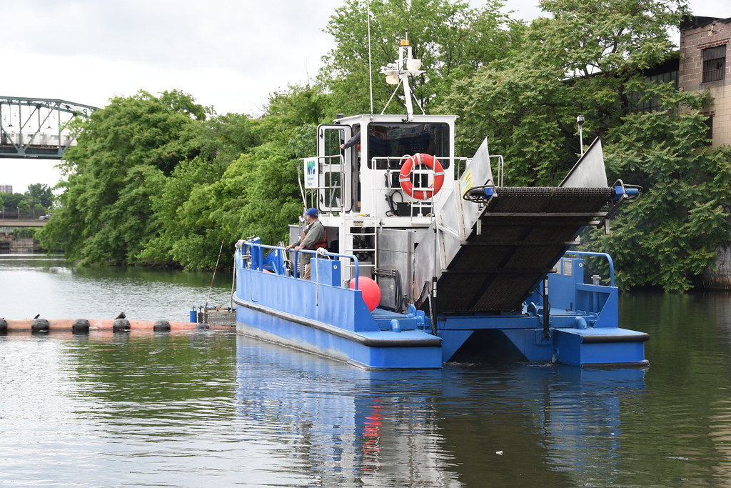 DEP Skimmer Boat Collecting Trash and Debris