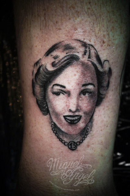 Woman with 13th necklace tattoo (Friday 13th party)