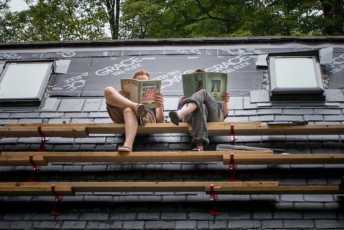 Us Reading Slating Books on Slate Roof of Straw Bale Cottage   by goingslowly