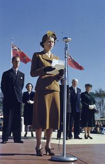 Princess Elizabeth speaking at microphone holding paper / La princesse Élizabeth parlant au microphone et tenant un papier