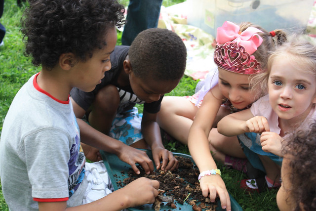 Children exploring compost and worms.
