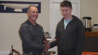 Emlyn Perry receiving the Junior Capsize trophy | by PLSC (Panmure Lagoon Sailing Club)
