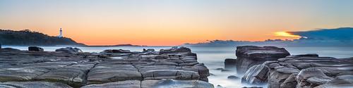 ocean longexposure morning sea lighthouse water sunrise rocks pano australia panoramic nsw newsouthwales centralcoast noclouds norahhead rockshelf norahheads
