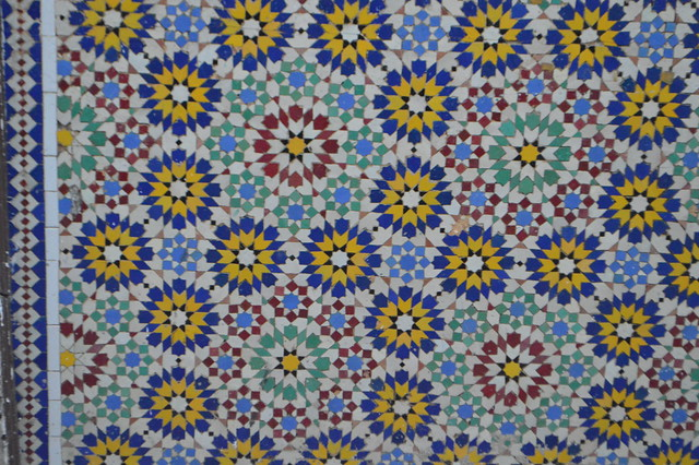 Blue white yellow and red tile pattern in Collectivité de Saint-Martin France French side of the island of Saint Martin