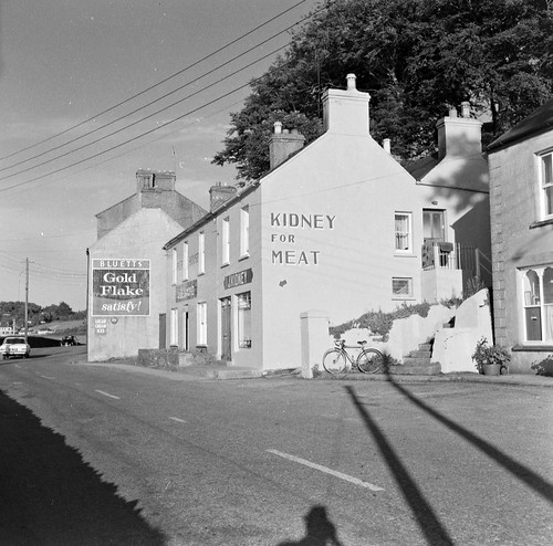 trees ireland shadow cars bicycle june shop wednesday advertising village cork 1966 icecream shops postbox cocacola letterbox 1960s sixties munster racer butchers 22nd selfie lowerroad racingbike crosshaven pierhouse fryscocoa fitzgibbons goldflake nationallibraryofireland gablewall bluetts somethingbeginningwithp jamespodea goldflakesatisfy lucancreamices jdesmond jkidney kidneyformeat vhftelevisionaerial lucandairies odeaphotographiccollection