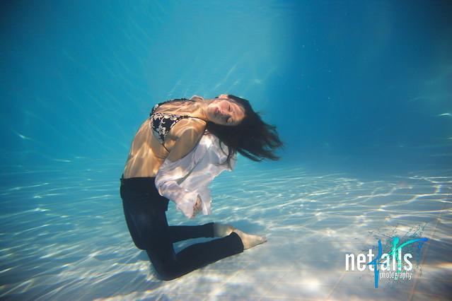 Woman wearing a jeans underwater
