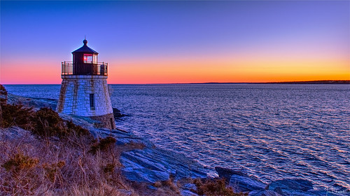 castlehilllighthouse castlehill lighthouse building navigation nautical transportation sea ocean bay narragansettbay seascape sunset sunrise sky