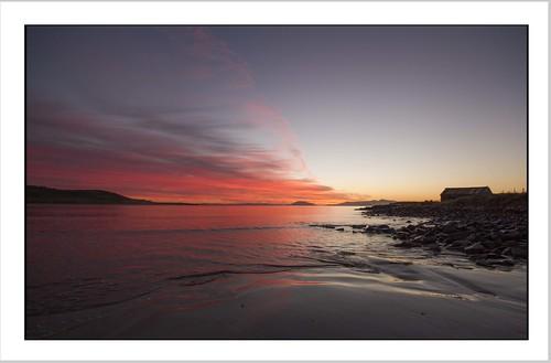 red sky orange clouds sunrise rocks tasmania boatshed mayfieldbay