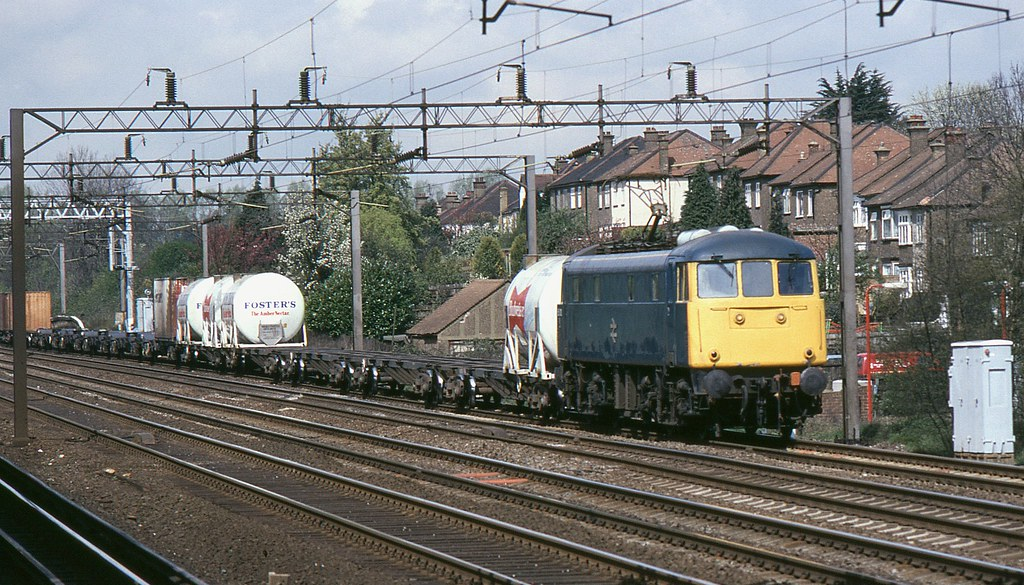 BR Class 85 85010 with up freight passing South Kenton on 13th. April 1989 by Crewcastrian