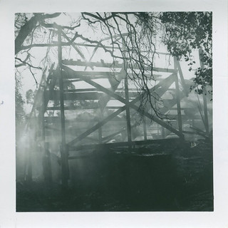 Smoke rising from charred bleachers at the Greek Theater, November 2, 1950, as seen from the rear.
