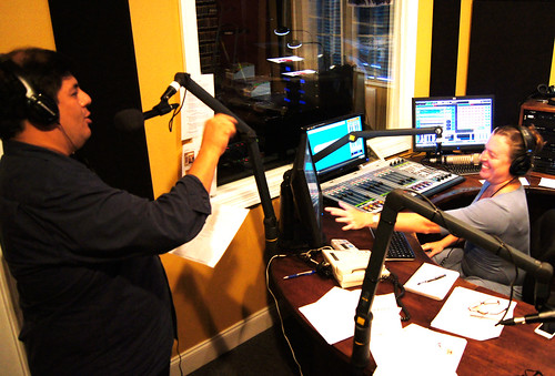 WWOZ's Jorge Fuentes and show host. Suzanne Corley on-air during Thursday afternoon for the 2012 fall pledge drive.  Photo Bill Sasser.