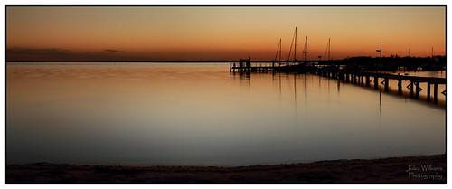 photoborder jetty serene outdoor dusk sunset silhouette muted soft waterfront beach water newsouthwales australia sand canon 70d
