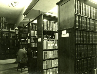 Rows of library stacks in Carnegie Library circa 1952